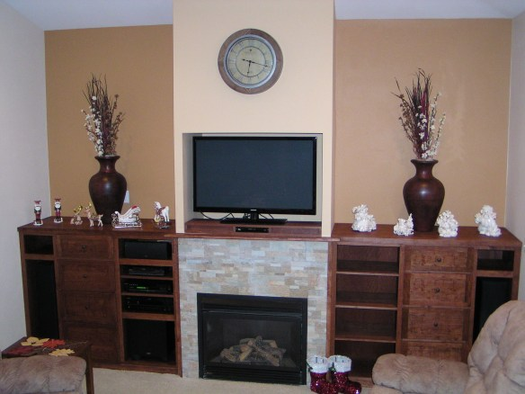 Custom cherry built-in cabinets add attractive storage around a fireplace, including room for stereo components and speakers.