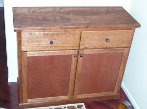 A cherry buffet cabinet provides space to serve food to guests plus storage for dishes between parties.