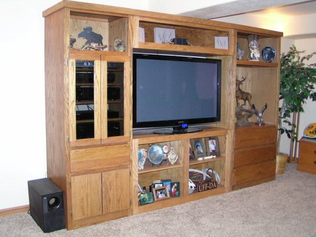 Oak Entertainment Center and Wall Units, custom designed to fit around a large flat-screened television