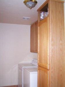 Laundry Room Cabinets, custom built to fit above and around washer and dryer