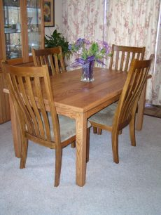 Oak Dining Table, with simple lines to enhance any decor, can be built to fit available space