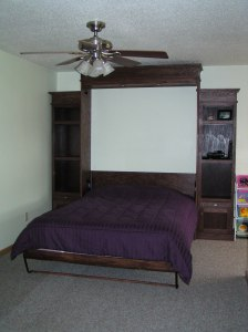 A Murphy bed (wall bed) provides a comfortable place for overnight guests to sleep.