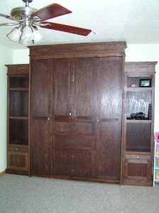 The Murphy bed (wall bed) folds up, making room for children to play when guests are gone.